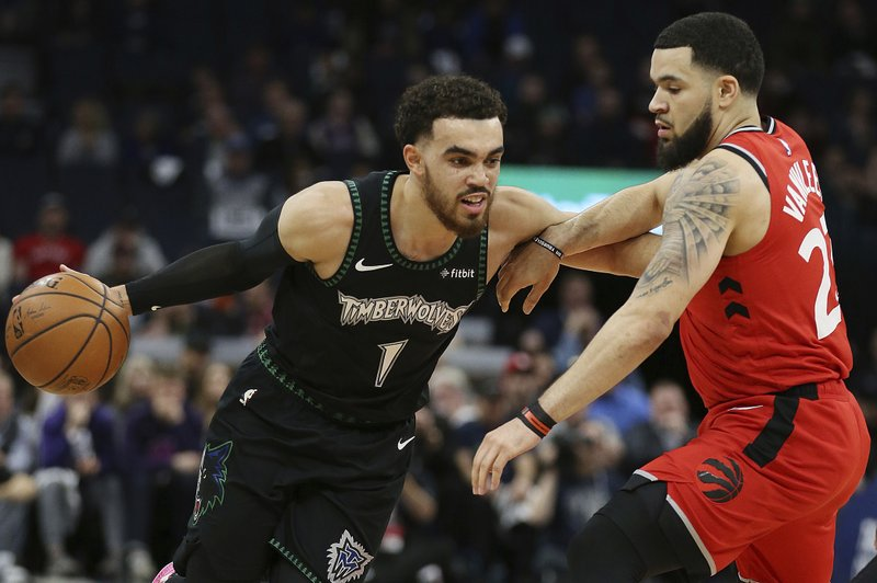 Minnesota Timberwolves' Tyus Jones drives the ball around Toronto Raptors' Fred VanVleet in the first half of an NBA basketball game Tuesday April 9, 2019, in Minneapolis. (AP Photo/Stacy Bengs)