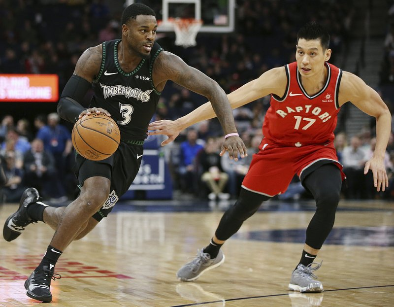 Minnesota Timberwolves' Jared Terrell controls the ball around Toronto Raptors' Jeremy Lin in the first half of an NBA basketball game Tuesday April 9, 2019, in Minneapolis. (AP Photo/Stacy Bengs)