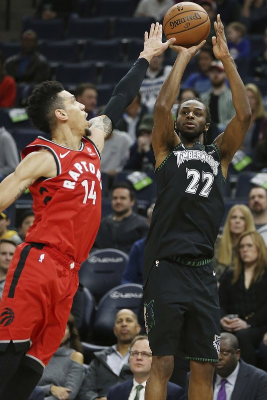 Minnesota Timberwolves' Andrew Wiggins shoots the ball against Toronto Raptors' Danny Green in the first half of an NBA basketball game Tuesday April 9, 2019, in Minneapolis. (AP Photo/Stacy Bengs)