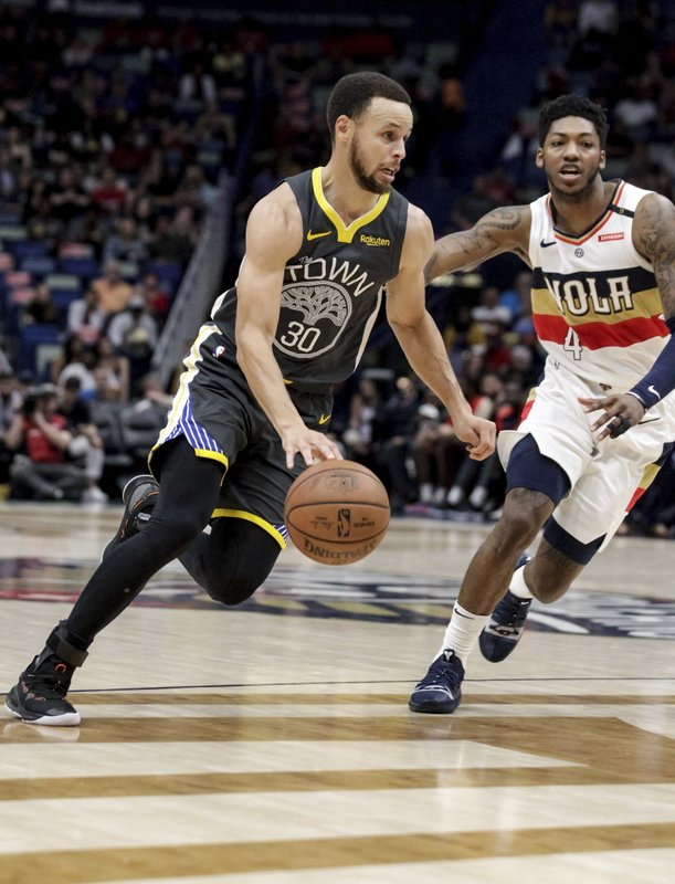 Golden State Warriors guard Stephen Curry (30) drives against New Orleans Pelicans guard Elfrid Payton (4) in the first half of an NBA basketball game in New Orleans, Tuesday, April 9, 2019. (AP Photo/Scott Threlkeld)