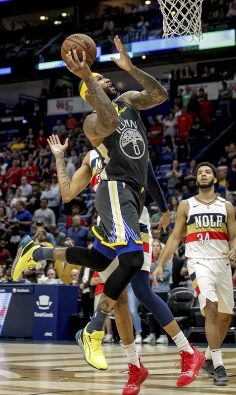 Golden State Warriors center DeMarcus Cousins (0) goes for a shot against the New Orleans Pelicans in the first half of an NBA basketball game in New Orleans, Tuesday, April 9, 2019. (AP Photo/Scott Threlkeld)