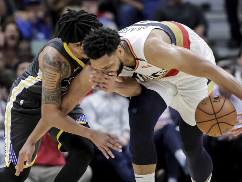 Golden State Warriors guard Damion Lee (1) and New Orleans Pelicans center Jahlil Okafor (8) battle for a loose ball in the first half of an NBA basketball game in New Orleans, Tuesday, April 9, 2019. (AP Photo/Scott Threlkeld)
