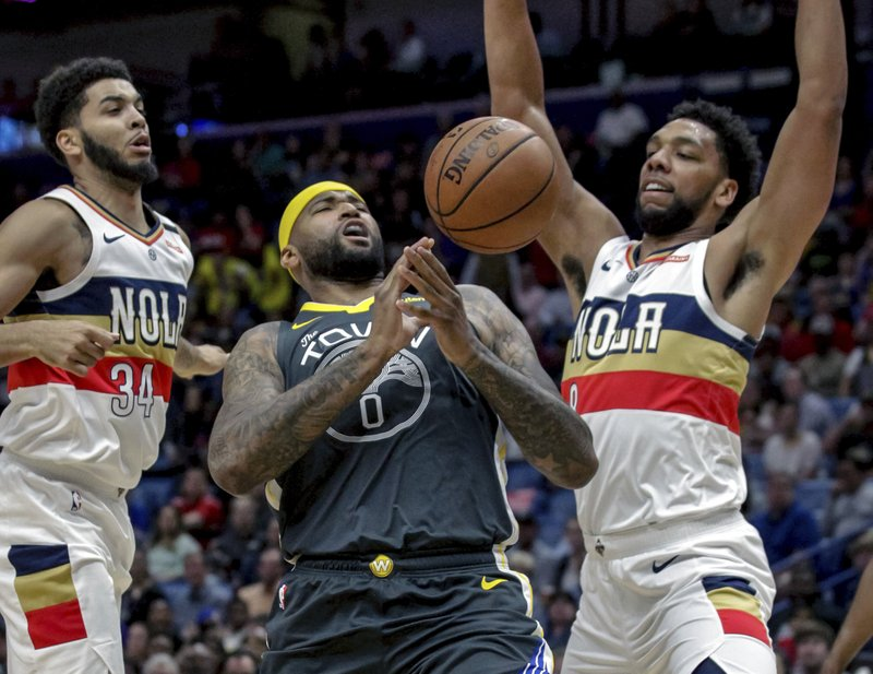 Golden State Warriors center DeMarcus Cousins (0) loses control of the ball while driving to the basket against New Orleans Pelicans guard Kenrich Williams (34) and center Jahlil Okafor (8) in the first half of an NBA basketball game in New Orleans, Tuesday, April 9, 2019. (AP Photo/Scott Threlkeld)