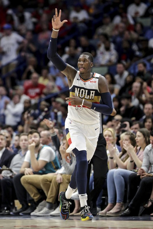 New Orleans Pelicans forward Cheick Diallo (13) celebrates after sinking a three-point basket against the Golden State Warriors in the first half of an NBA basketball game in New Orleans, Tuesday, April 9, 2019. (AP Photo/Scott Threlkeld)