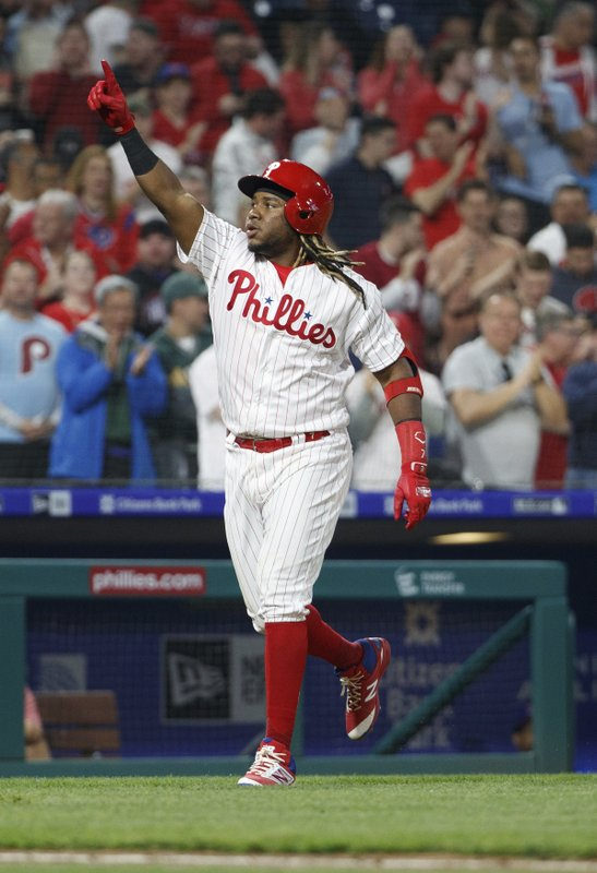 Philadelphia Phillies' Maikel Franco gestures as he nears home plate after hitting a home run during the third inning of the team's baseball game against the Washington Nationals, Tuesday, April 9, 2019, in Philadelphia. (AP Photo/Chris Szagola)