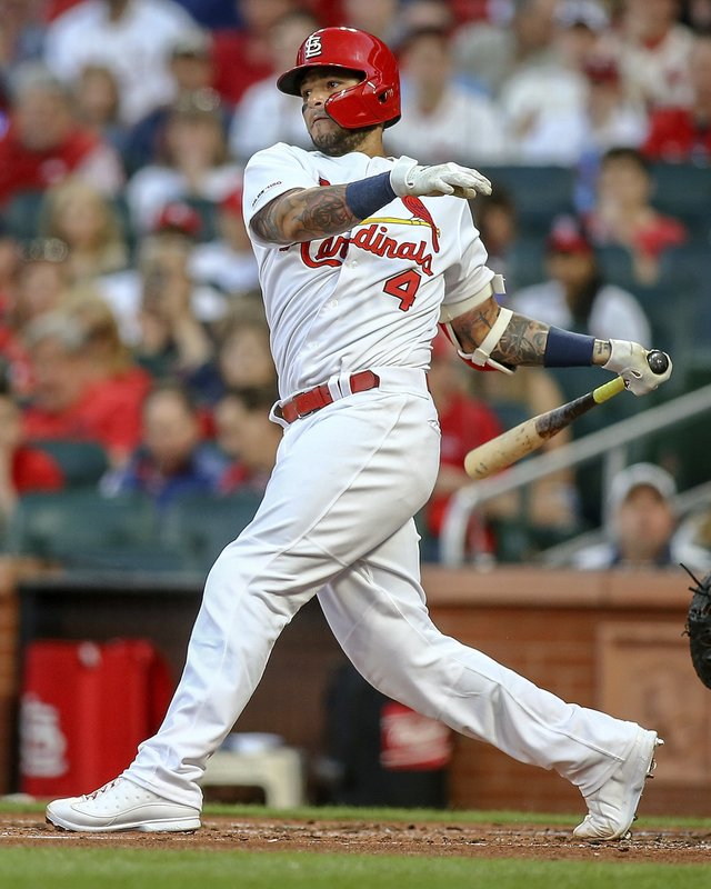 St. Louis Cardinals' Yadier Molina follows through on an RBI double during the first inning of the team's baseball game against the Los Angeles Dodgers on Tuesday, April 9, 2019, in St. (AP Photo/Scott Kane)