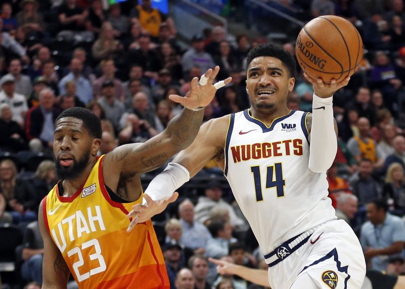 Denver Nuggets guard Gary Harris (14) drives to the basket as Utah Jazz forward Royce O'Neale (23) defends in the first half during an NBA basketball game Tuesday, April 9, 2019, in Salt Lake City. (AP Photo/Rick Bowmer)