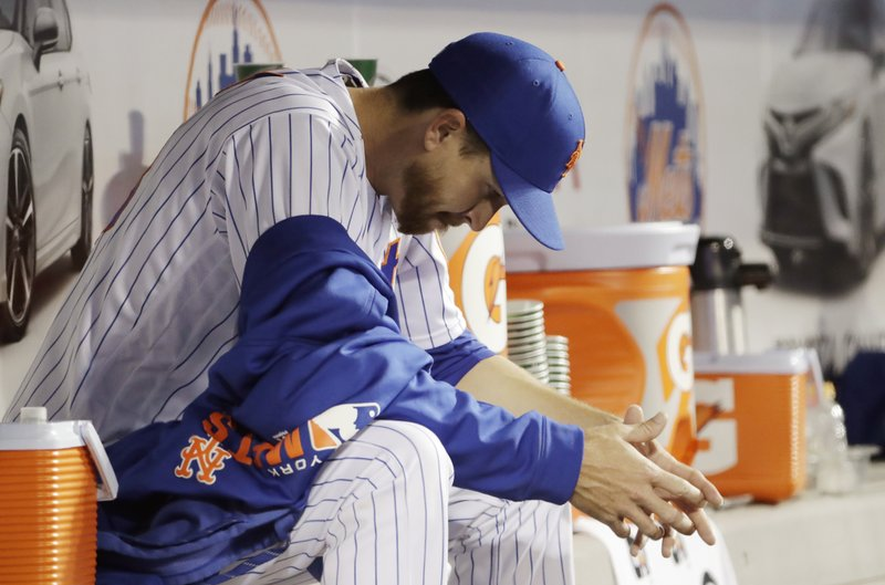 New York Mets starting pitcher Jacob deGrom, last year's National League Cy Young award winner, sits in the dugout after allowing six runs during the first four innings of an interleague baseball game against the Minnesota Twins, Tuesday, April 9, 2019, in New York. (AP Photo/Kathy Willens)