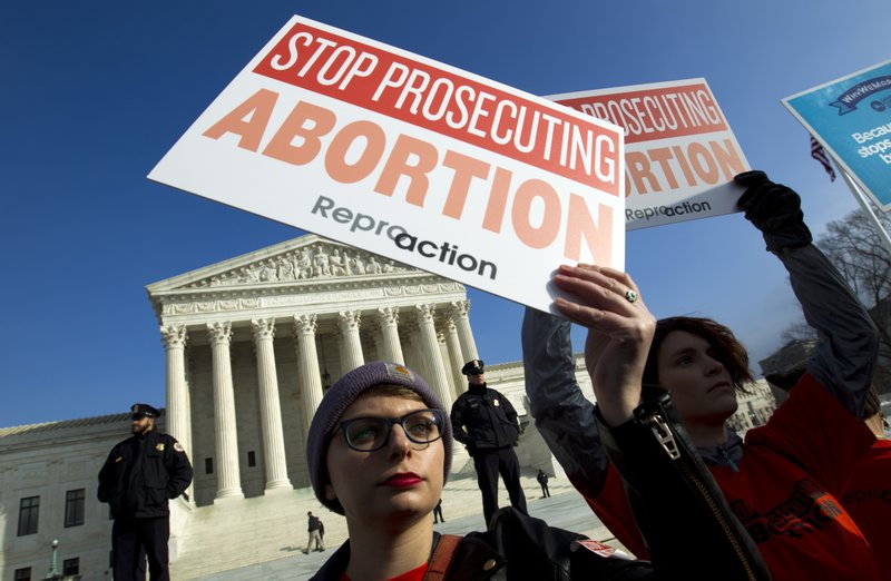 FILE - In this Jan. 18, 2019, file photo, abortion rights activists protest outside of the U.S. Supreme Court, during the March for Life in Washington. (AP Photo/Jose Luis Magana, File)