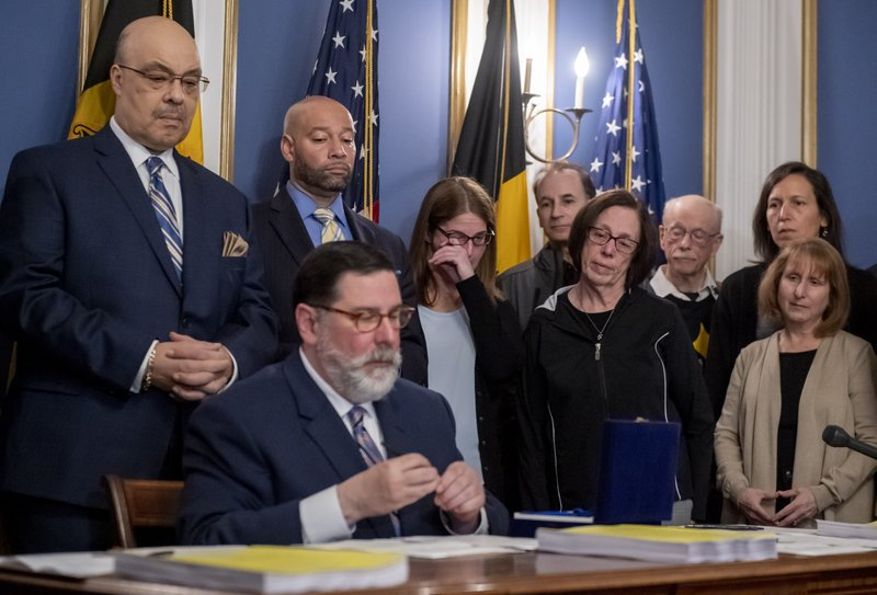 Leigh Stein, daughter of Tree of Life synagogue shooting victim Dan Stein, wipes away a tear as Pittsburgh Mayor Bill Peduto signs three gun-control bills into law, Tuesday, April 9, 2019, at the City-County Building in downtown Pittsburgh. (Steph Chambers/Pittsburgh Post-Gazette via AP)