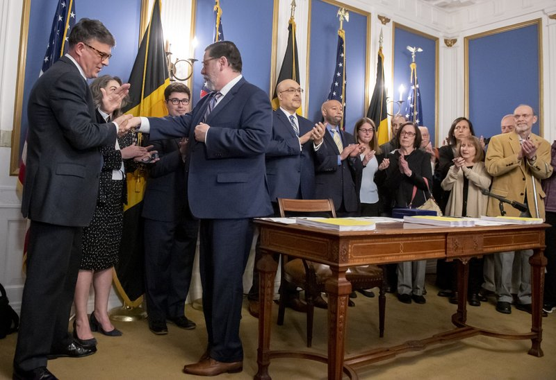 Pittsburgh Mayor Bill Peduto shakes hands with supporters and family members of Tree of Life synagogue shooting victims after he signed three gun-control bills into law, Tuesday, April 9, 2019, at the City-County Building in downtown Pittsburgh. (Steph Chambers/Pittsburgh Post-Gazette via AP)