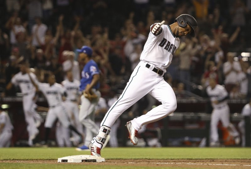 Arizona Diamondbacks' Jarrod Dyson celebrates his two-run walk-off home run against the Texas Rangers in a baseball game Tuesday, April 9, 2019, in Phoenix. (AP Photo/Ross D. Franklin)