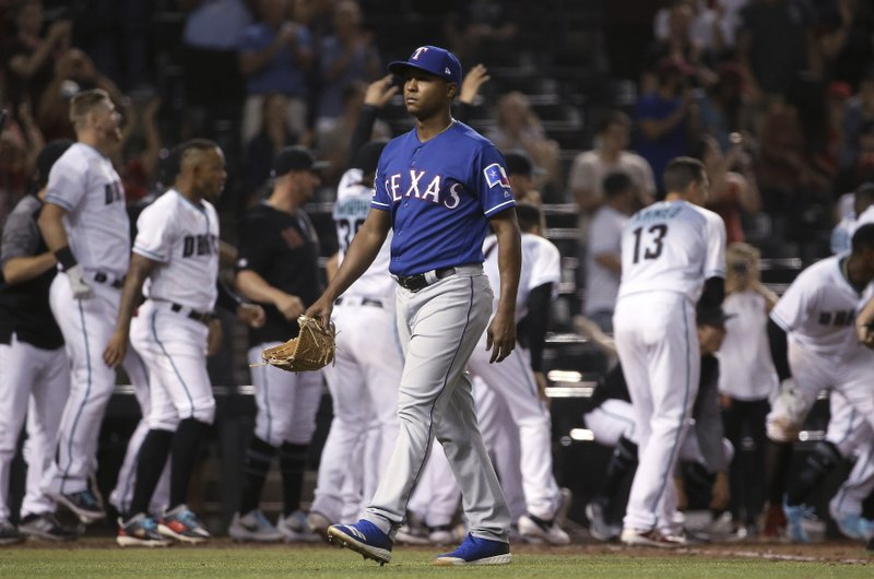 Texas Rangers relief pitcher Jose Leclerc walks off the field after giving up a walk-off, two-run home run to Arizona Diamondbacks' Jarrod Dyson in a baseball game Tuesday, April 9, 2019, in Phoenix. (AP Photo/Ross D. Franklin)