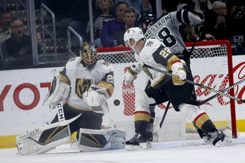 Vegas Golden Knights goalie Marc-Andre Fleury (29) defends on a shot by Los Angeles Kings forward Carl Grundstrom (38) during the third period of an NHL hockey game Saturday, April 6, 2019, in Los Angeles. (AP Photo/Ringo H.W. Chiu)