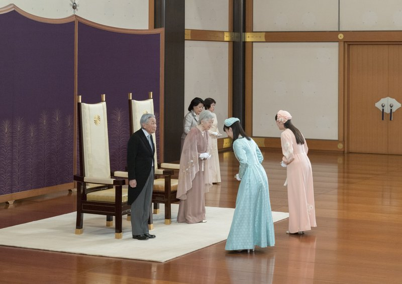 In this photo provided by the Imperial Household Agency, Japan's Emperor Akihito, left, and Empress Michiko, second from left, are celebrated by Princess Mako, right, and Princess Kako during a celebration marking their 60th wedding anniversary at the Imperial Palace in Tokyo, Wednesday, April 10, 2019. (The Imperial Household Agency of Japan via AP)