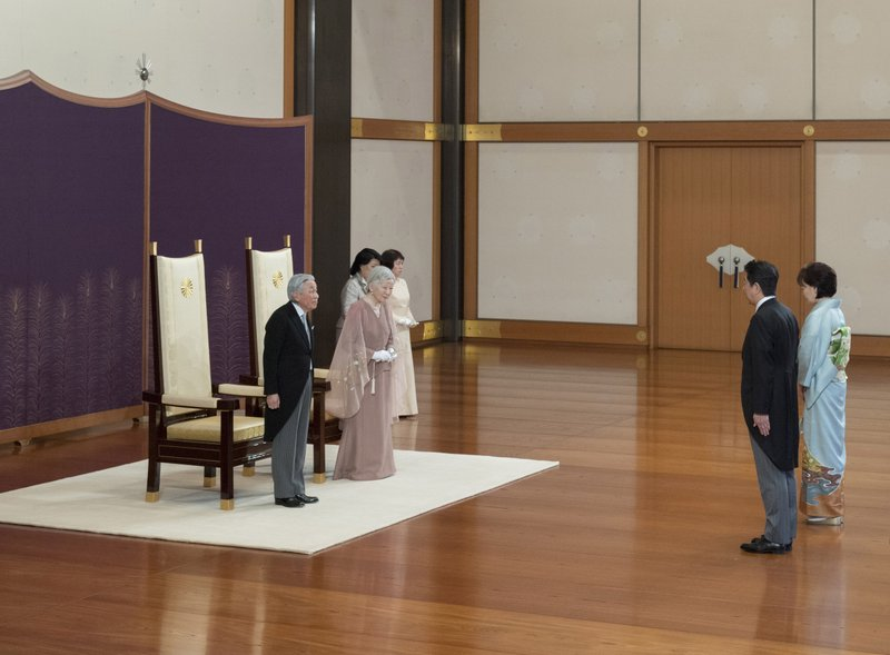 In this photo provided by the Imperial Household Agency, Japan's Emperor Akihito, left, and Empress Michiko, second from left, are greeted by Prime Minister Shinzo Abe and his wife Akie during a celebration marking their 60th wedding anniversary at the Imperial Palace in Tokyo, Wednesday, April 10, 2019. (The Imperial Household Agency of Japan via AP)