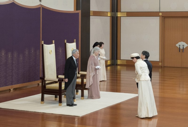 In this photo provided by the Imperial Household Agency, Japan's Emperor Akihito, left, and Empress Michiko, second from left, are greeted by Crown Prince Naruhito, right, and Crown Princess Masako second from right, as they celebrate their 60th wedding anniversary at the Imperial Palace in Tokyo, Wednesday, April 10, 2019. (The Imperial Household Agency of Japan via AP)