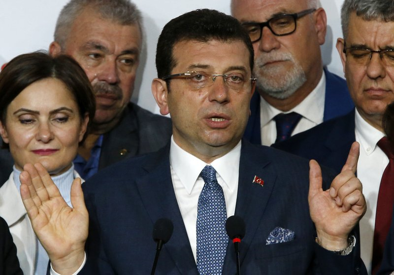 Ekrem Imamoglu, the opposition, Republican People's Party's (CHP) mayoral candidate in Istanbul, talks to members of the media, in Istanbul, Tuesday, April 9, 2019. (AP Photo/Lefteris Pitarakis)