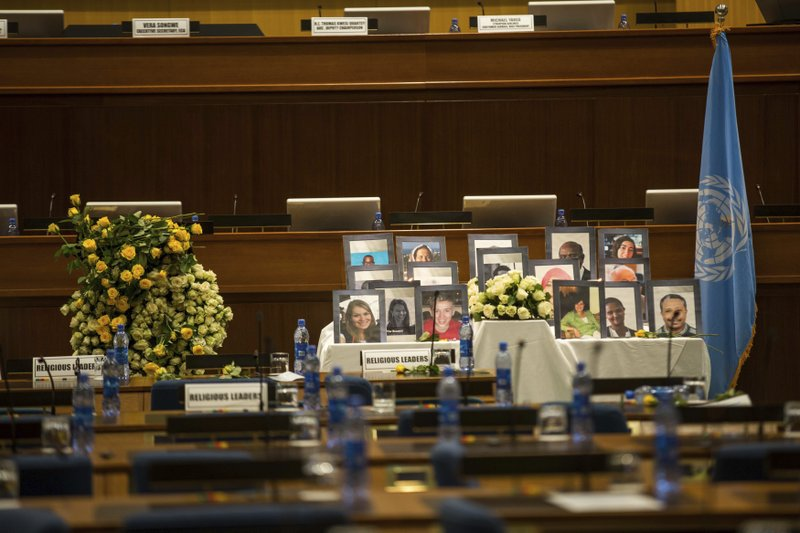 Photos of the UN and NGO Personnel on display Wednesday, April 10, 2019, in Addis Ababa, Ethiopia, during a somber memorial marking one month since the Ethiopian Airlines crash and the many humanitarian workers killed. The event in Ethiopia's capital was organized for 21 United Nations staffers and 12 aid workers killed when the flight crashed minutes after takeoff from Addis Ababa en route to Nairobi, with all 157 people on board killed.AP Photo/Mulugeta Ayene)