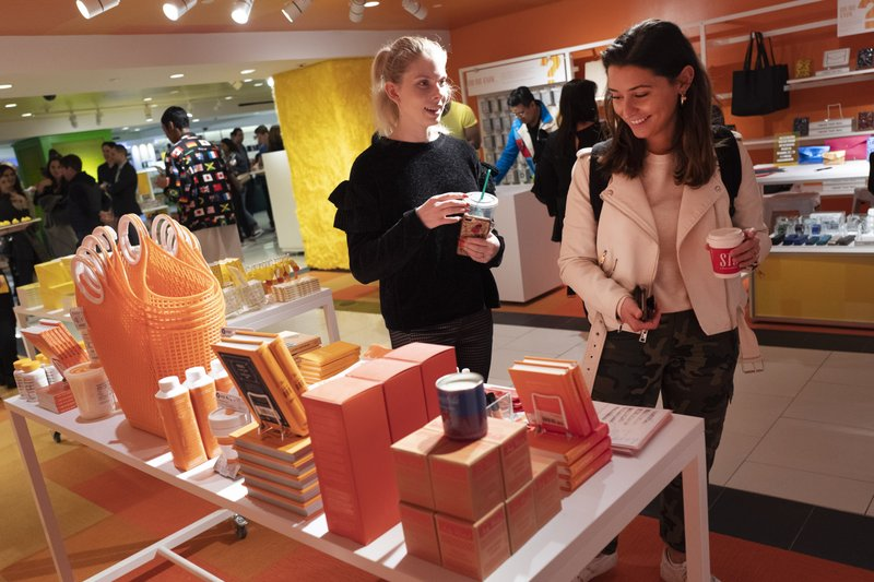Visitors to Story walk through the shop now located at Macy's, Wednesday, April 10, 2019, in New York. (AP Photo/Mark Lennihan)