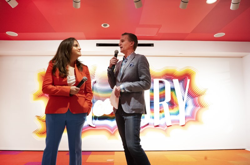 Rachel Shechtman, left, founder of Story, and Macy's CEO Jeff Gennette give a presentation on Story's opening day at Macy's, Wednesday, April 10, 2019, in New York. (AP Photo/Mark Lennihan)