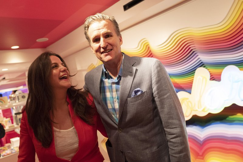 Rachel Shechtman, left, founder of Story, and Macy's CEO Jeff Gennette embrace after giving a presentation on Story's opening day at Macy's, Wednesday, April 10, 2019, in New York. (AP Photo/Mark Lennihan)