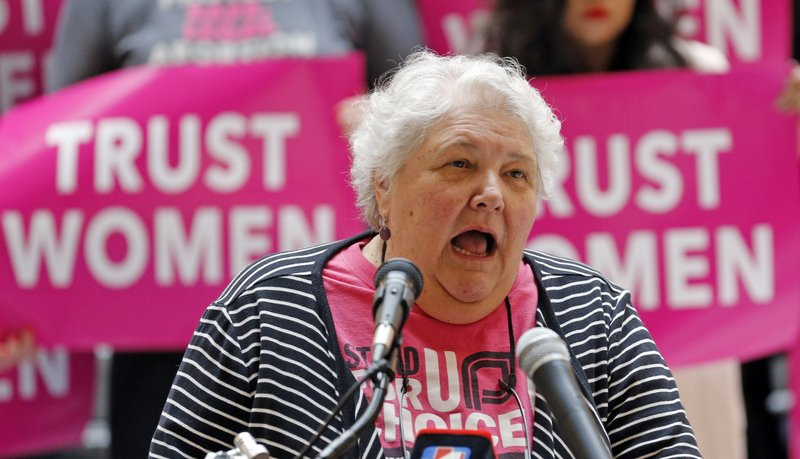 Karrie Galloway, of Planned Parenthood Association of Utah, speaks during a news conference at the Utah State Capitol Wednesday, April 10, 2019, in Salt Lake City. (AP Photo/Rick Bowmer)