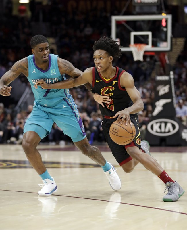 Cleveland Cavaliers' Collin Sexton (2) drives past Charlotte Hornets' Dwayne Bacon (7) in the first half of an NBA basketball game, Tuesday, April 9, 2019, in Cleveland. (AP Photo/Tony Dejak)