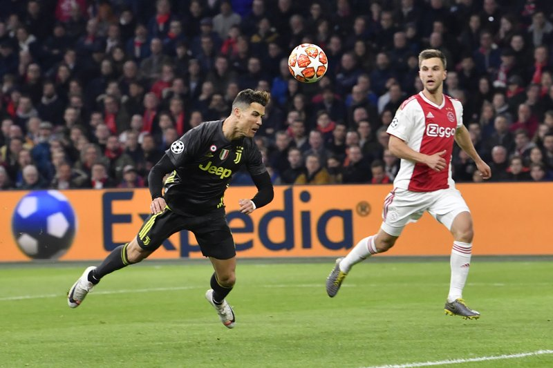 Juventus' Cristiano Ronaldo scores his side's opening goal during the Champions League quarterfinal, first leg, soccer match between Ajax and Juventus at the Johan Cruyff ArenA in Amsterdam, Netherlands, Wednesday, April 10, 2019. (AP Photo/Martin Meissner)