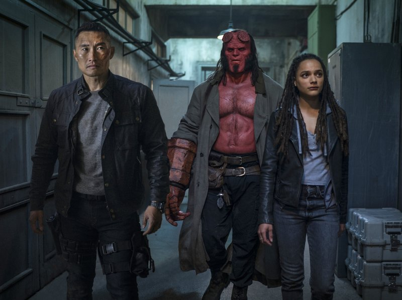 This image released by Lionsgate shows, from left, Daniel Dae Kim, David Harbour and Sasha Lane in a scene from