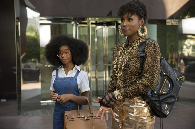 This image released by Universal Pictures shows Marsai Martin, left, and Issa Rae in a scene from