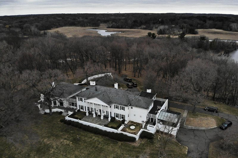 This aerial photo shows Irwin Jacobs home in Orono, Minn., Wednesday, April 20, 2019. Authorities are investigating the deaths of two people found at the Lake Minnetonka mansion of Irwin Jacobs, a prominent Minnesota businessman who once owned a minority share in the Minnesota Vikings NFL team. (Aaron Lavinsky/Star Tribune via AP)
