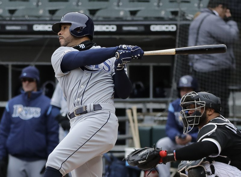 Tampa Bay Rays' Tommy Pham hits a two-run home run against the Chicago White Sox during the first inning of a baseball game in Chicago, Wednesday, April 10, 2019. (AP Photo/Nam Y. Huh)