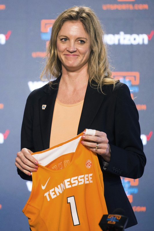 Kellie Harper holds a jersey during a press conference announcing her as the new head coach of the Lady Vols, in the Ray and Lucy Hand Studio on University of Tennessee's campus Wednesday, April 10, 2019 in Knoxville, Tenn. (Caitie McMekin/Knoxville News Sentinel via AP)