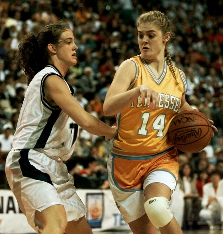 FILE - In this March 30, 1997, file photo, Tennessee's Kellie Jolly (14) drives against Old Dominion defender Stacy Himes (11) in the first half at the NCAA Women's Final Four Basketball Tournament in Cincinnati. (Jolly) played for the Lady Vols when they were regularly winning national champions. She now takes over a Tennessee program that's in a much different place, as it hasn't even reached the Sweet 16 over the last three years. Tennessee is banking on the former Missouri State coach to get this storied program back to national prominence. (AP Photo/Elise Amendola, File)