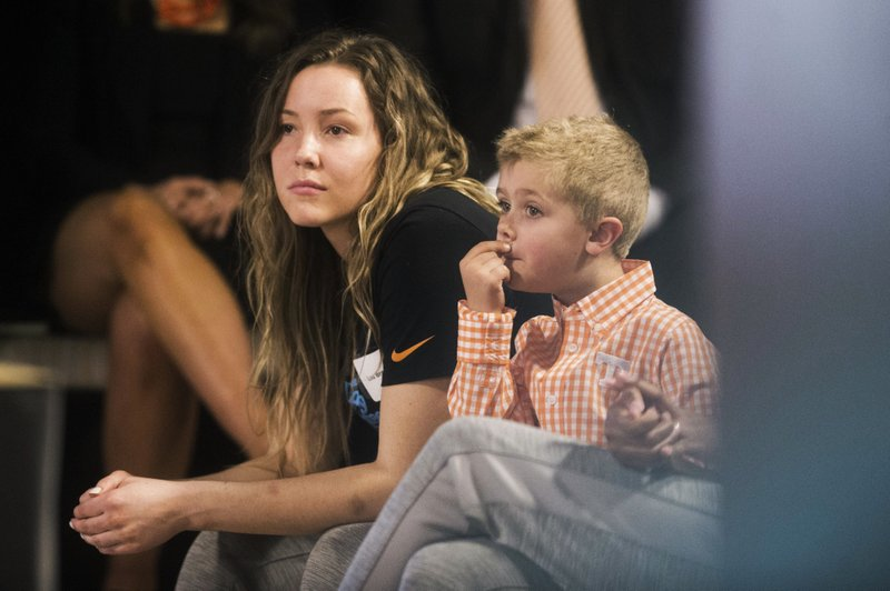 Tennessee's Lou Brown sits next to Kellie Harper's son Jackson during a press conference announcing Harper as the new head coach of the Lady Vols, in the Ray and Lucy Hand Studio on University of Tennessee's campus Wednesday, April 10, 2019 in Knoxville, Tenn. (Caitie McMekin/Knoxville News Sentinel via AP)