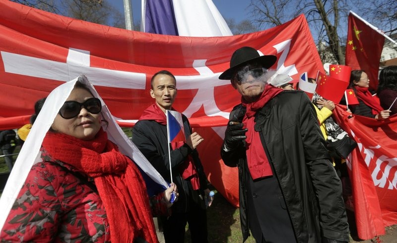 FILE - In this March 29, 2016, file photo, China supporters attend a rally in support of Chinese President Xi Jinping during his visit in Prague, Czech Republic. (AP Photo/Petr David Josek, File)