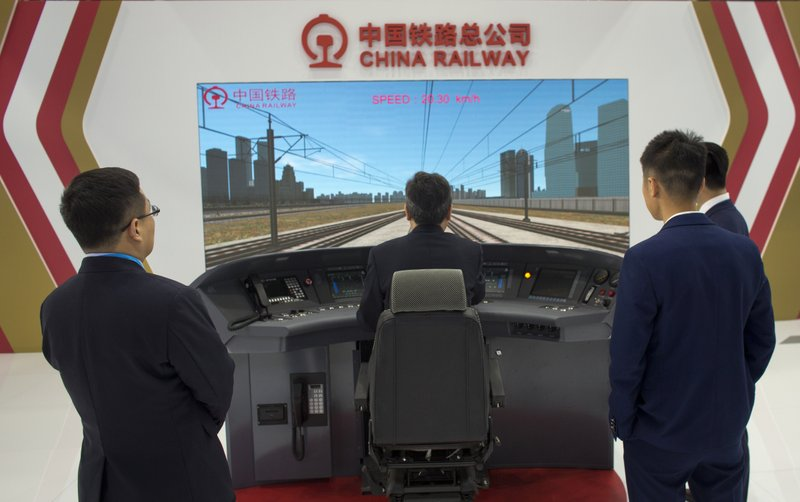 In this photo taken Tuesday, April 9, 2019, simulator of of Chinese high speed train is displayed at the trade fair in Mostar, Bosnia. (AP Photo/Darko Bandic)