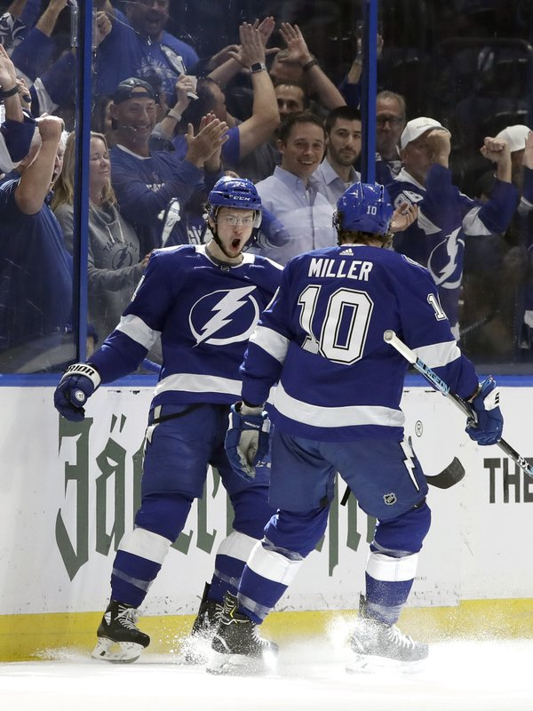 Tampa Bay Lightning center Anthony Cirelli (71) celebrates his goal against the Columbus Blue Jackets with center J. (10) during the first period of Game 1 of an NHL Eastern Conference first-round hockey playoff series Wednesday, April 10, 2019, in Tampa, Fla. (AP Photo/Chris O'Meara)