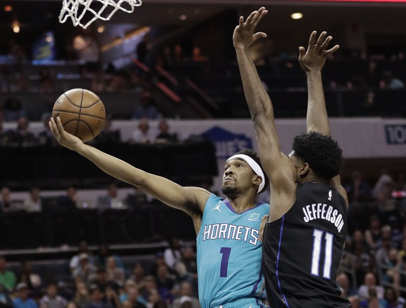 Charlotte Hornets' Malik Monk (1) drives against Orlando Magic's Amile Jefferson (11) during the first half of an NBA basketball game in Charlotte, N. (AP Photo/Chuck Burton)