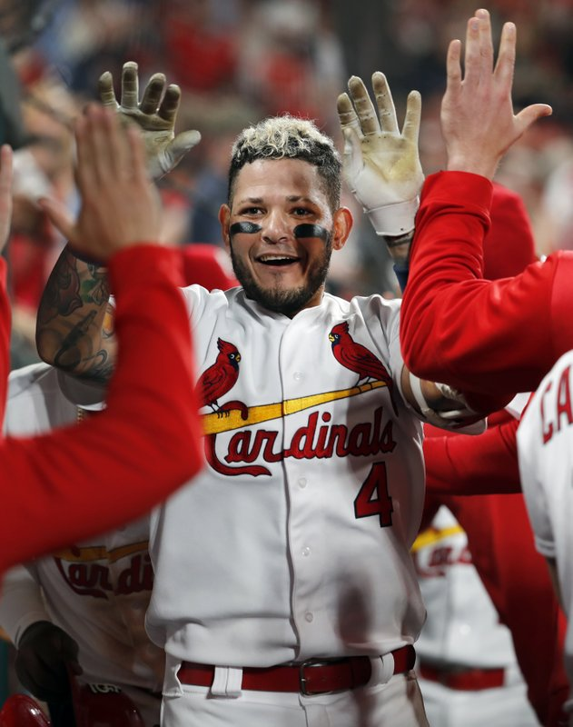 St. Louis Cardinals' Yadier Molina is congratulated by teammates in the dugout after hitting a two-run home run during the sixth inning of the team's baseball game against the Los Angeles Dodgers on Wednesday, April 10, 2019, in St. (AP Photo/Jeff Roberson)