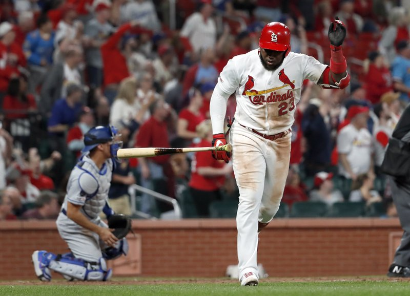 St. Louis Cardinals' Marcell Ozuna (23) tosses aside his bat as Los Angeles Dodgers catcher Austin Barnes, left, watches a two-run home run by Ozuna during the eighth inning of a baseball game Wednesday, April 10, 2019, in St. (AP Photo/Jeff Roberson)