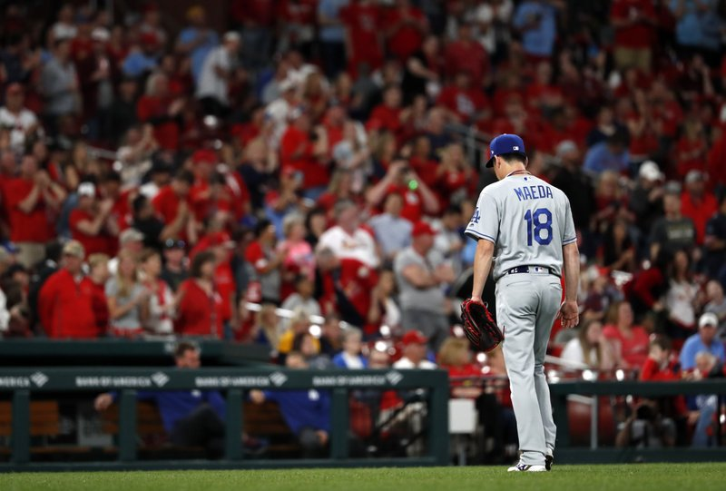Los Angeles Dodgers starting pitcher Kenta Maeda leaves the baseball game after giving up a two-run home run to St. (AP Photo/Jeff Roberson)