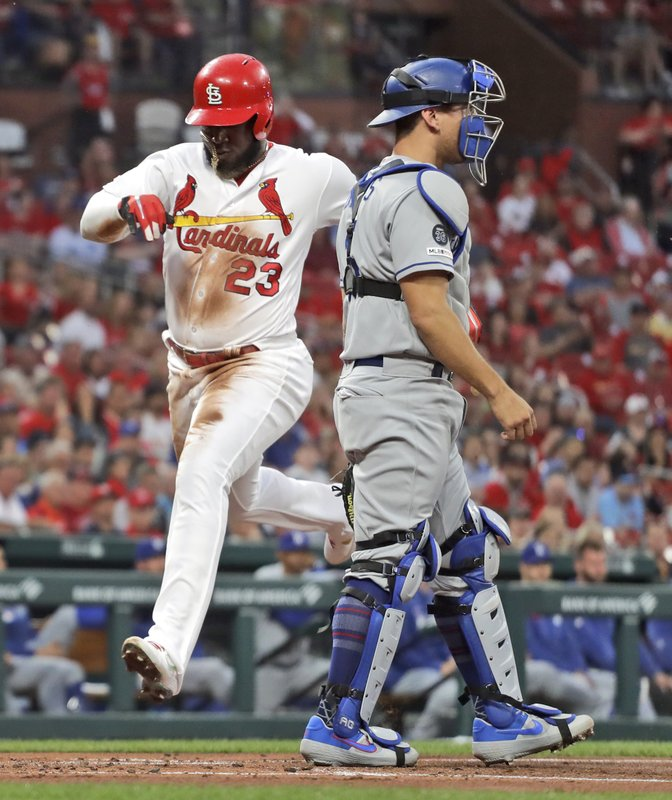 St. Louis Cardinals' Marcell Ozuna (23) scores past Los Angeles Dodgers catcher Austin Barnes during the second inning of a baseball game Wednesday, April 10, 2019, in St. (AP Photo/Jeff Roberson)