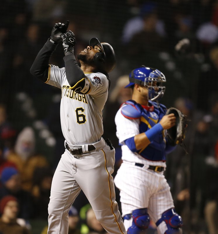 Pittsburgh Pirates' Starling Marte celebrates his two-run home run during the third inning of the teams baseball game against the Chicago Cubs in Chicago, Wednesday, April 10, 2019. (AP Photo/Nuccio DiNuzzo)