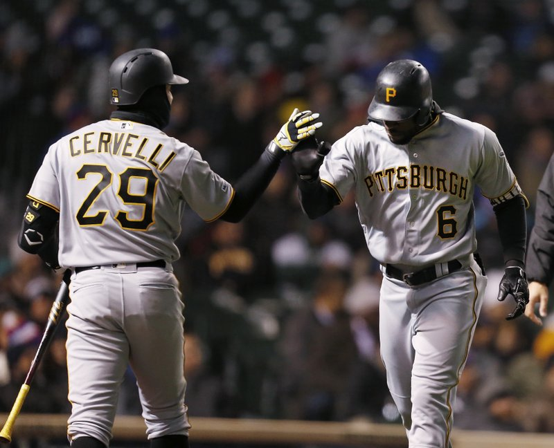 Pittsburgh Pirates' Francisco Cervelli congratulates Starling Marte after his two-run home run against the Chicago Cubs during the third inning of a baseball game in Chicago, Wednesday, April 10, 2019. (AP Photo/Nuccio DiNuzzo)