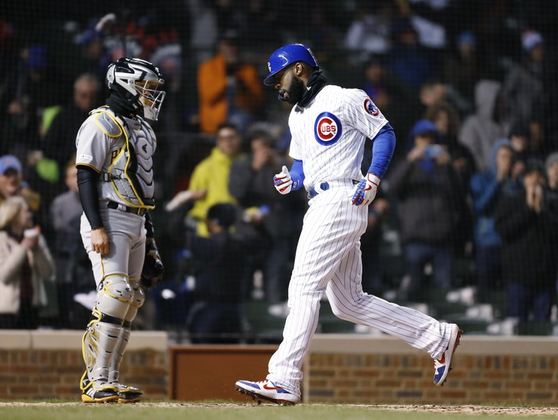 Chicago Cubs' Jason Heyward scores on his solo home during the fifth inning of the team's baseball game against the Pittsburgh Pirates in Chicago, Wednesday, April 10, 2019. (AP Photo/Nuccio DiNuzzo)