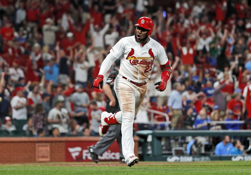 St. Louis Cardinals' Marcell Ozuna celebrates as he runs the bases after hitting a two-run home run during the eighth inning of a baseball game against the Los Angeles Dodgers on Wednesday, April 10, 2019, in St. (AP Photo/Jeff Roberson)