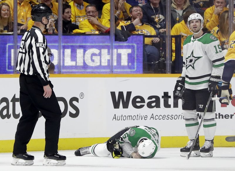 Dallas Stars center Jason Dickinson (16) lies on the ice after being injured during the first period in Game 1 of the team's NHL hockey first-round playoff series against the Nashville Predators on Wednesday, April 10, 2019, in Nashville, Tenn. (AP Photo/Mark Humphrey)
