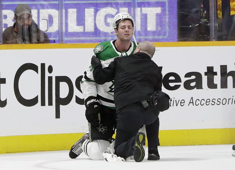 Dallas Stars center Jason Dickinson is attended to after being injured during the first period in Game 1 of the team's NHL hockey first-round playoff series against the Nashville Predators on Wednesday, April 10, 2019, in Nashville, Tenn. (AP Photo/Mark Humphrey)